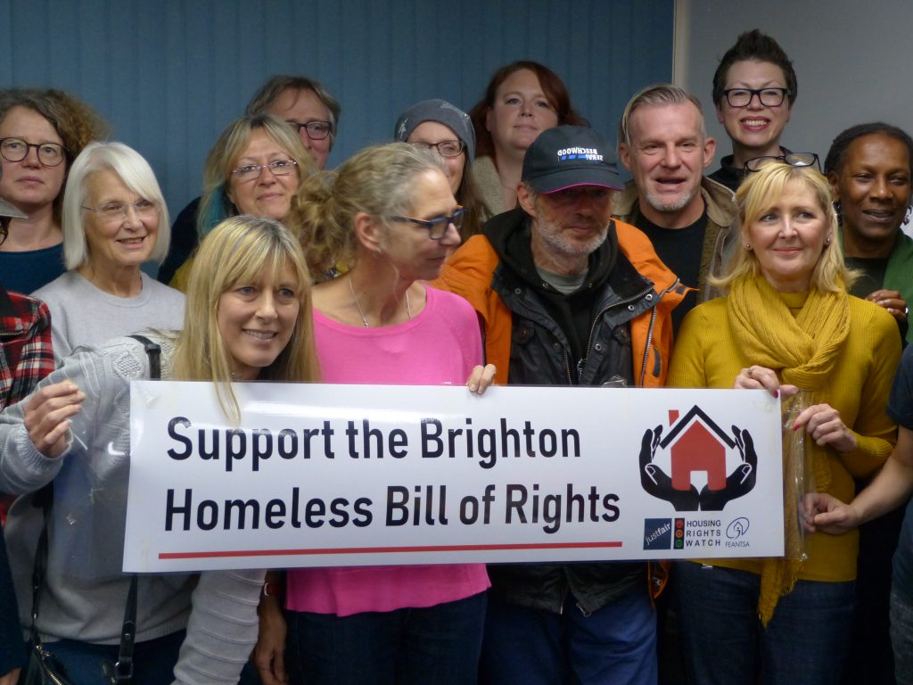 "Picture of 14 men and women, Labour party councillor candidates, holding a ""Support the Brighton Homeless Bill of Rights"" banner."